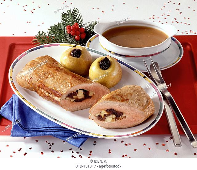 Roast pork with prune stuffing and baked apples