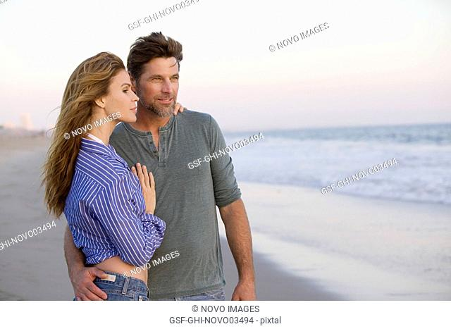 Half-Length Portrait of Mid-Adult Couple at Gazing at Ocean