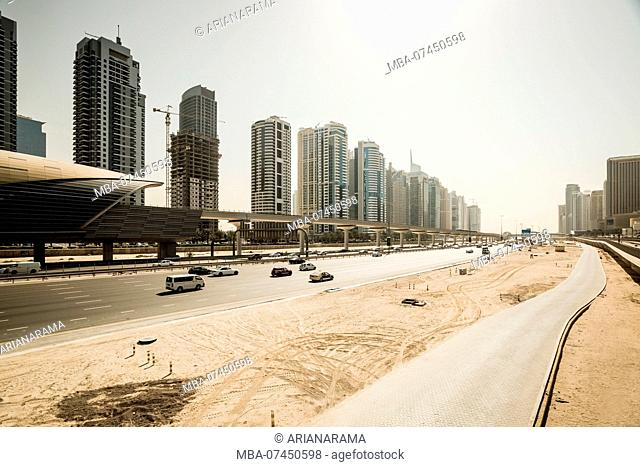 Futuristic skyline of Sheikh Zayed highway and metro station, Dubai, United Arab Emirates