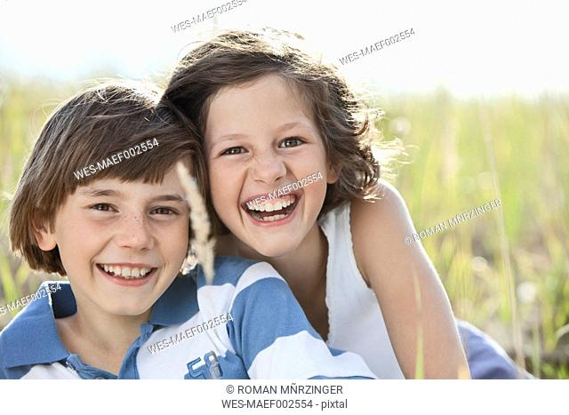 Germany, Bavaria, Boy 10-11 Years and girl 8-9 Years playing, smiling