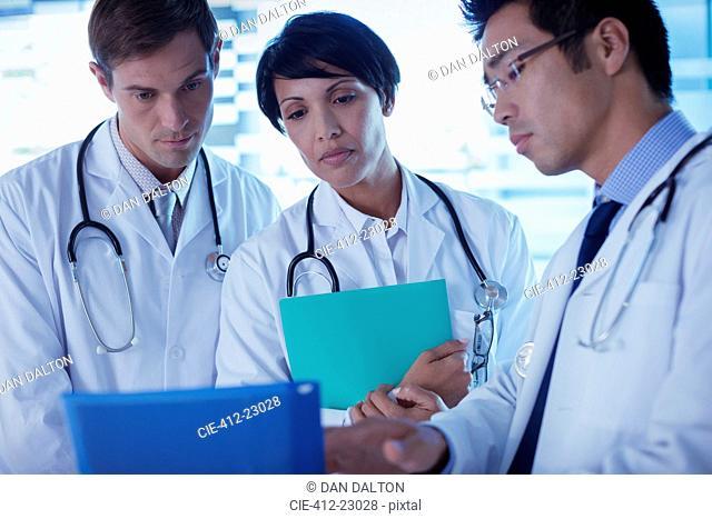 Doctors discussing patient's treatment