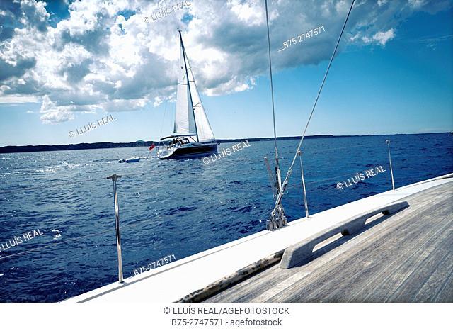 Sailboat and Northern coast of Minorca. Mediterranean Sea. Balearic Islands, Spain