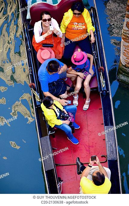 Gondola with tourists, Venice, Italy