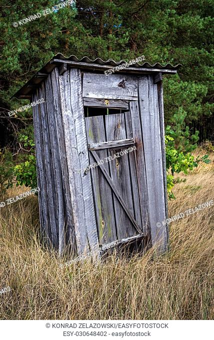 Old wooden privy in Mashevo abandoned village of Chernobyl Nuclear Power Plant Zone of Alienation area around nuclear reactor disaster in Ukraine