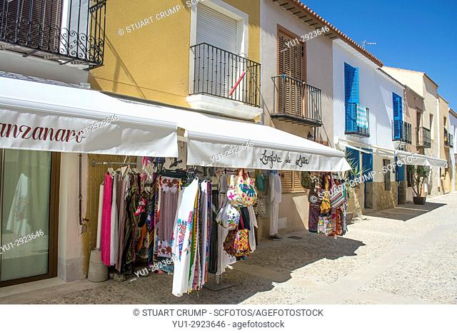 Shop front on the deserted main street of the Spanish island of Tabarca after the day trippers have departed