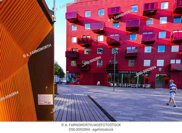A red coop apartment building in area known as Norra Djurgarden on the Storangstorget. Also known as the Royal Seaport. Stockholm, Sweden