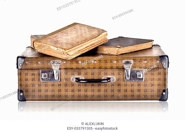 Vintage suitcase with books isolated on white background