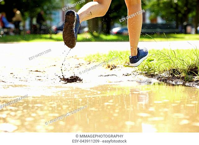 Close up portrait of female runner in mud puddle