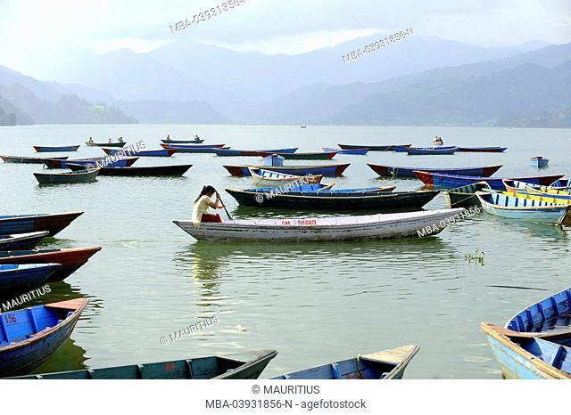 Boats on the Phewa Lake in Pokhara, Himalaya, Nepal, Asia