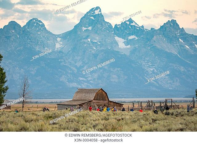 Group of photographers set up cameras in front of John Moulton Barn and Teton Mountain Range, Grand Tetons National Park, Teton County, Wyoming. USA