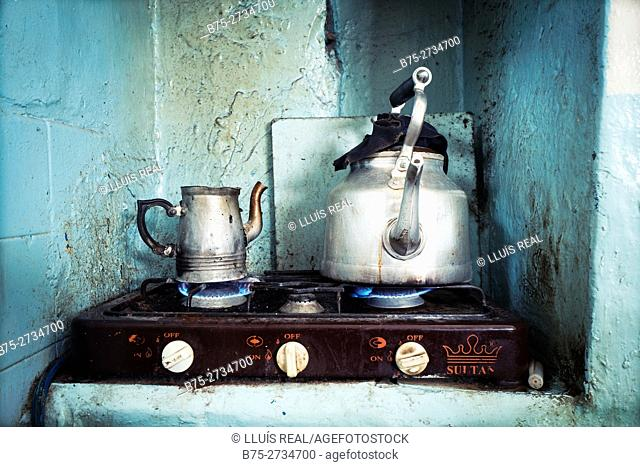 Close-up of a small gas cooker with two teapots on the heat in a cafe. Chaouen, Morocco