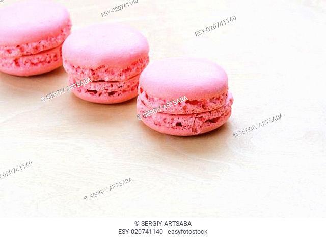 pink macaron on wooden background