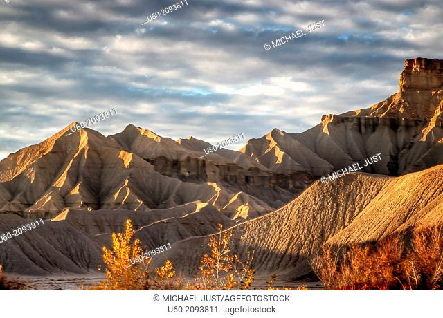 Unusual rock formation produced from erosion make up the surreal landscape near Factory Butte. Utah