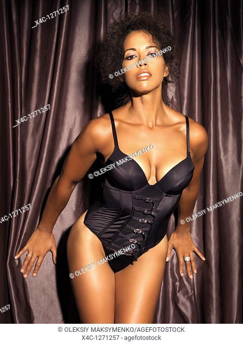 Glamorous woman wearing a black corset