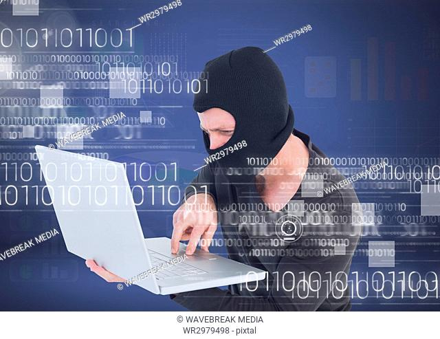 Hacker with hood using a laptop in front of 3D blue background
