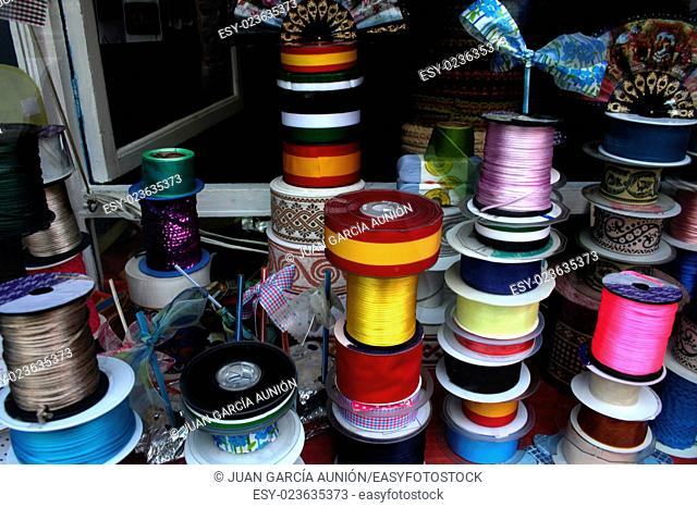 Shiny satin ribbons at traditional notions store, Spain