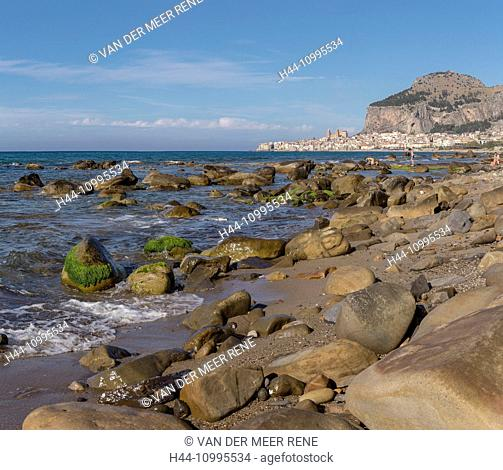 The city and the Rocca di Cefalu seen from the beach
