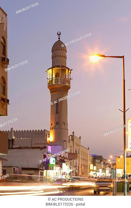 Time lapse view of traffic under tower, Manama, Bahrain
