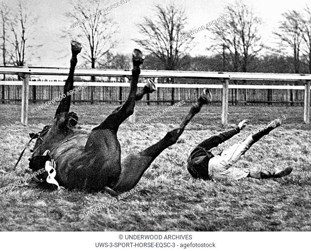 Gatwick, England: February 13, 1937.Both horse and rider find themselves in similar positions after a spill in the Brook Steeplechase