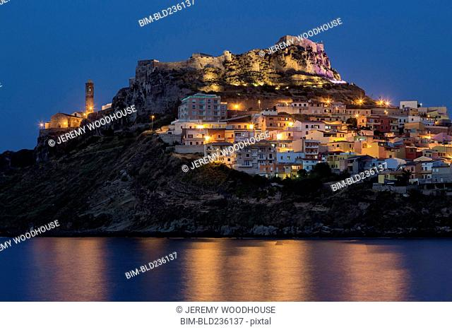 Illuminated waterfront cityscape on hill, Castelsardo, Provincia di Sassari, Italy