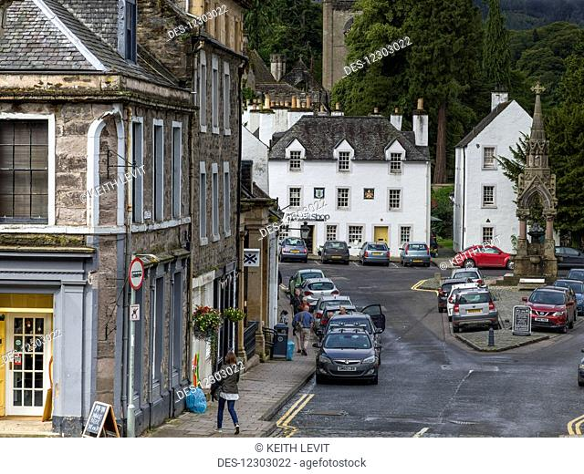 A street lined with parked cars in an urban area; Dunkeld, Perth and Kinross, Scotland