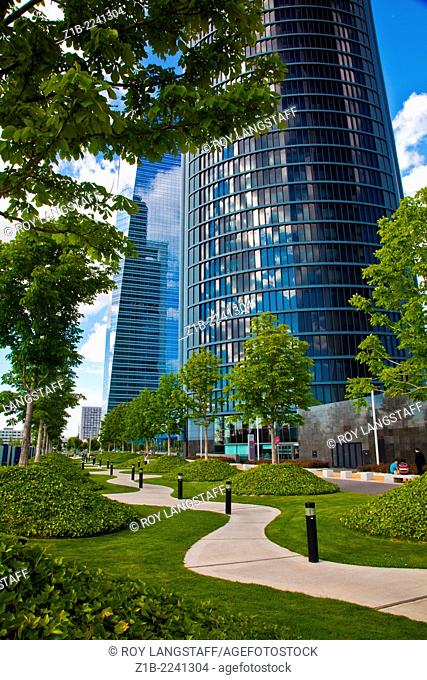 Landscaping around the base of Madrid's four glass towers in Chamartin
