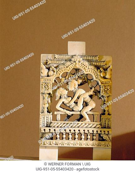 An ivory panel, probably from a bed or a swing, carved with a tantric scene
