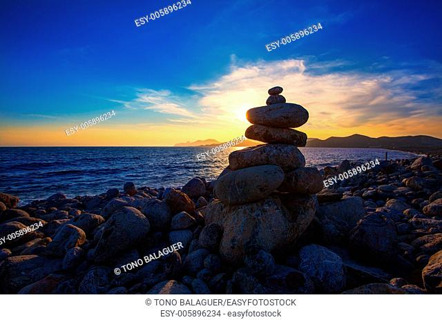 Ibiza Cap des Falco sunset with desire stones at the beach in Sant Josep Balearic Islands