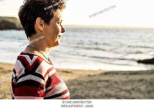 France, Crozon peninsula, Portrait of mature woman at beach
