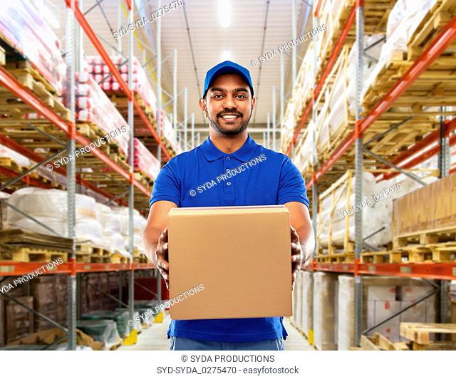 indian delivery man or warehouse worker with box