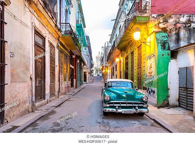 Parked vintage car in empty street, Havana, Cuba
