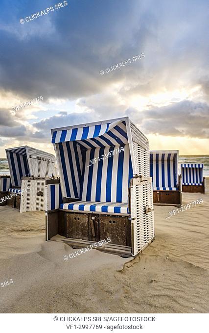 Kampen, Sylt island, North Frisia, Schleswig-Holstein, Germany. Strandkorbs on the beach at sunset