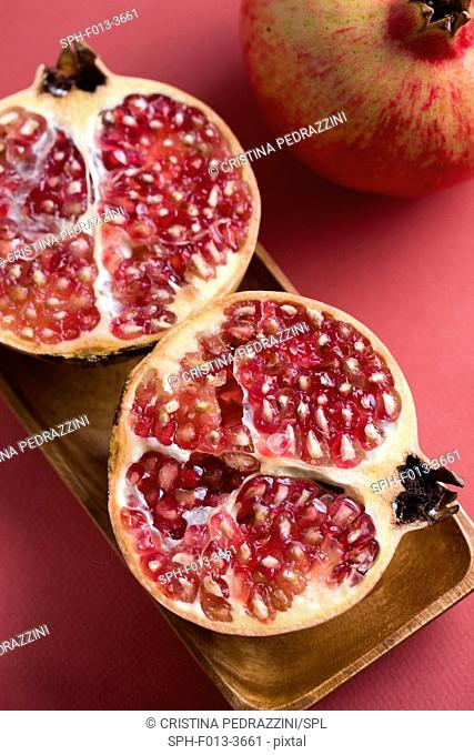 Pomegranate (Punica granatum) opened up with the seeds inside