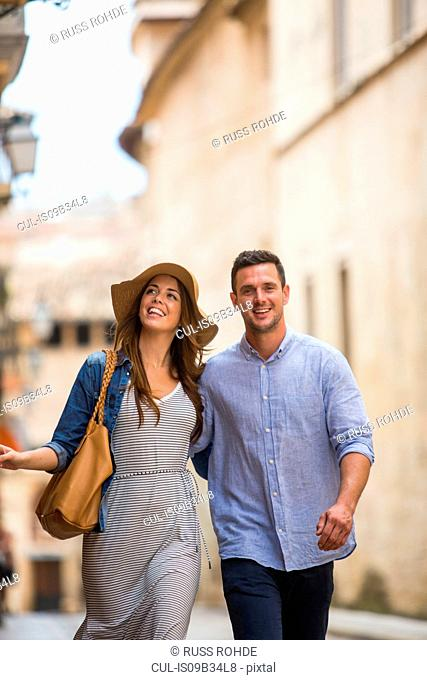 Couple walking on street, Palma de Mallorca, Spain