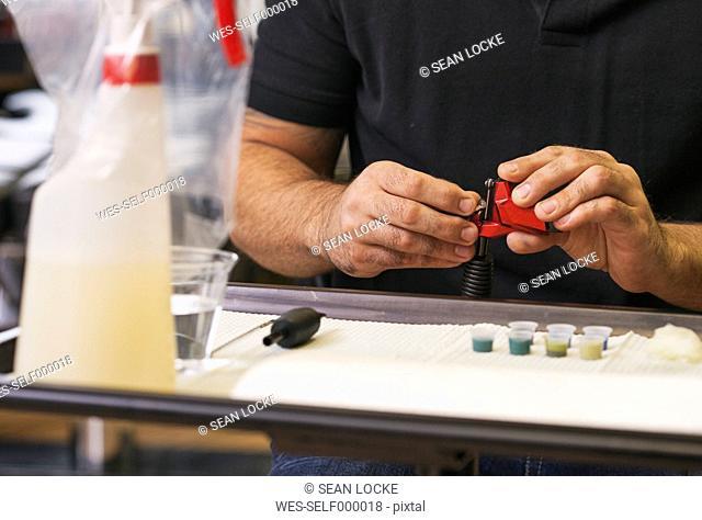 Tattooist preparing equipment in a tatoo studio