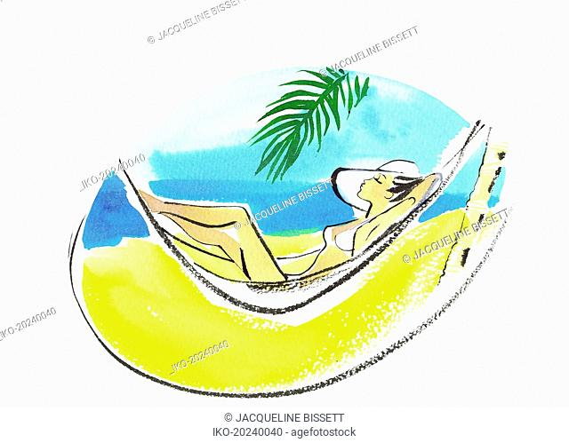 Beautiful woman sunbathing in hammock on tropical beach