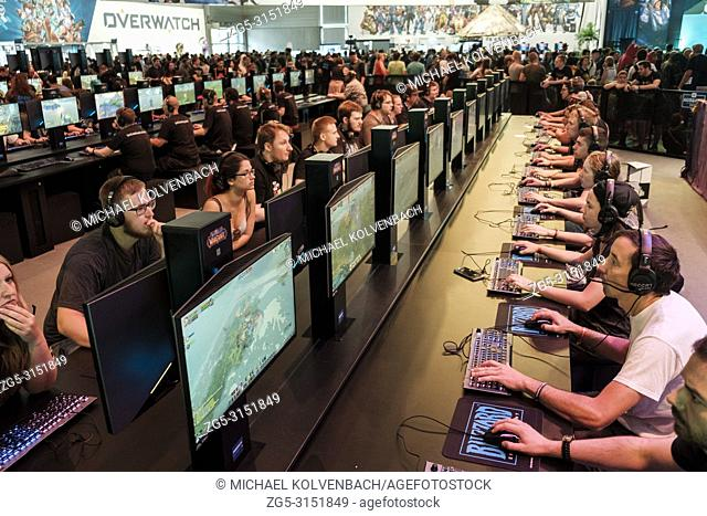 15892598d035 Visitors play the computer game World of Warcraft at the world s largest  fair for computer and