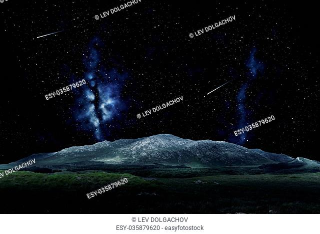 nature and astronomy concept - mountain landscape over night sky or space with shooting stars background