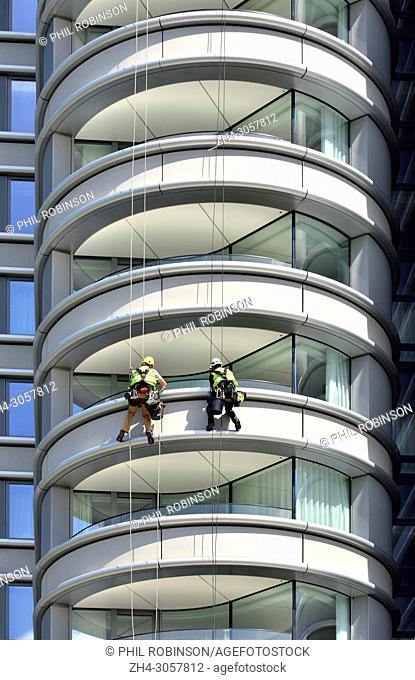 London,England, UK. Maintenance workeers abseiling down the building'The Corniche' apartments on Albert Embankment, Vauxhall