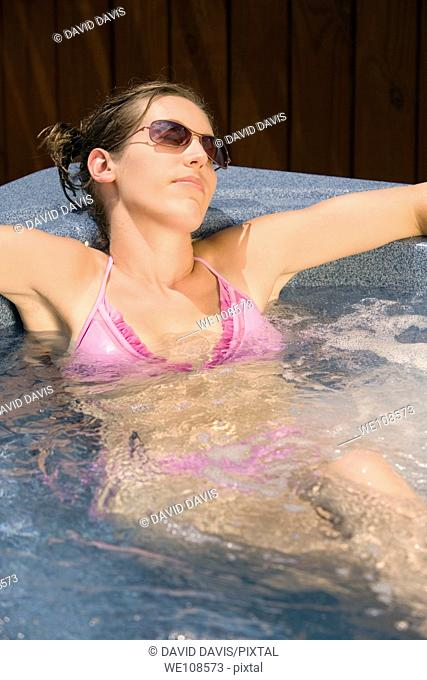 Young woman relaxing in Hottub