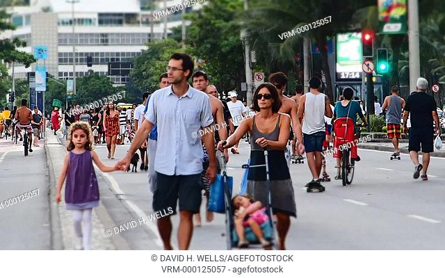 People walking and exercising when the road is closed on Ipanema, Rio De Janeiro, Brazil