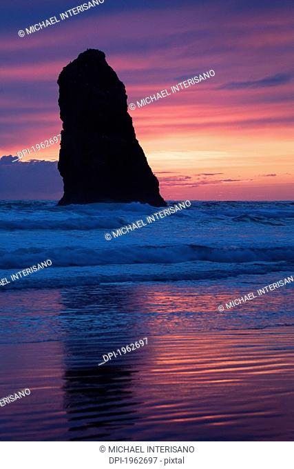 silhouette of a rock formation at sunset, cannon beach, oregon, united states of america