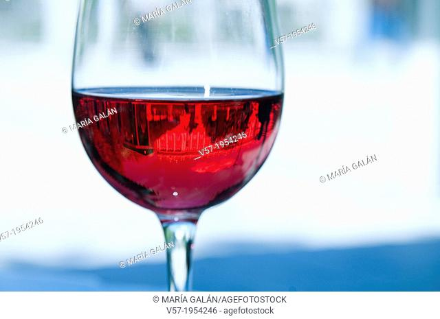 Royal Palace of Madrid viewed through a glass of rose wine. Madrid, Spain