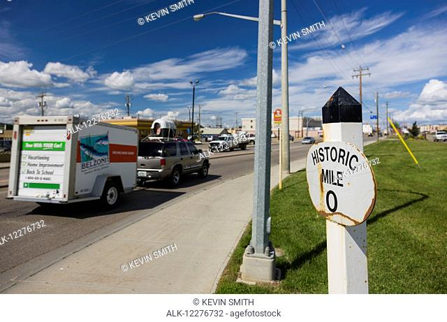Mile Zero of the Alaska Highway, a car driving by in the background, Dawson Creek, British Columbia, Canada, Summer