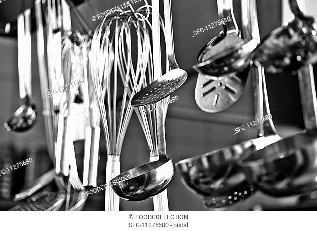Cooking utensils hanging in a restaurant kitchen