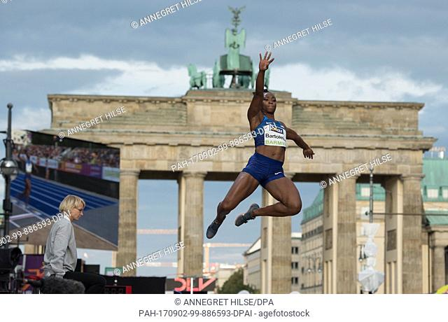 "US long jumper Tianna Bartoletta in action in front of the Brandenburg Gate during the German Athletics Association (DLV) international competition """"Berlin..."