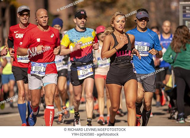 Runners pass through Harlem in New York near the 22 mile mark near Mount Morris Park on Sunday, November 4, 2018 in the 48th annual TCS New York City Marathon