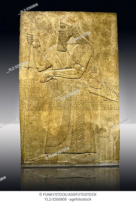 Assyrian relief sculpture panel of King Ashurnaspiral II with his sword and a staff. The panel is possibly from his private apartments