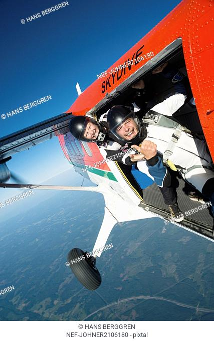 Skydivers in plane