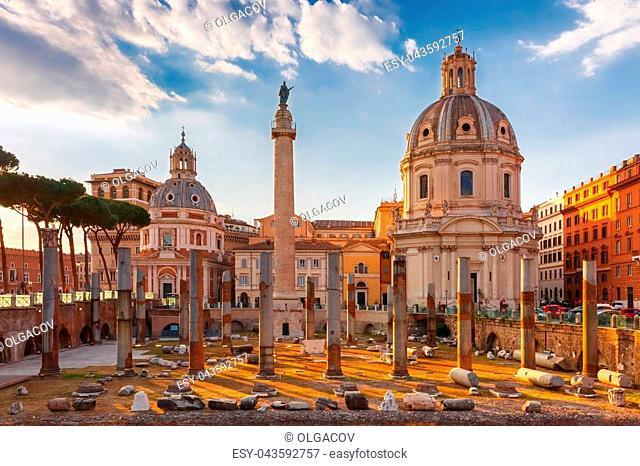 Ancient ruins of Trajan Forum, Trajan Column and churches Santa Maria di Loreto and Most Holy Name of Mary at the Trajan Forum at sunset in Rome, Italy